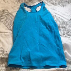 IVIVVA: blue tank top